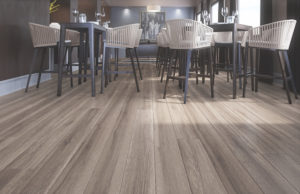 Grey/brown CorkWood floors in a dining space.