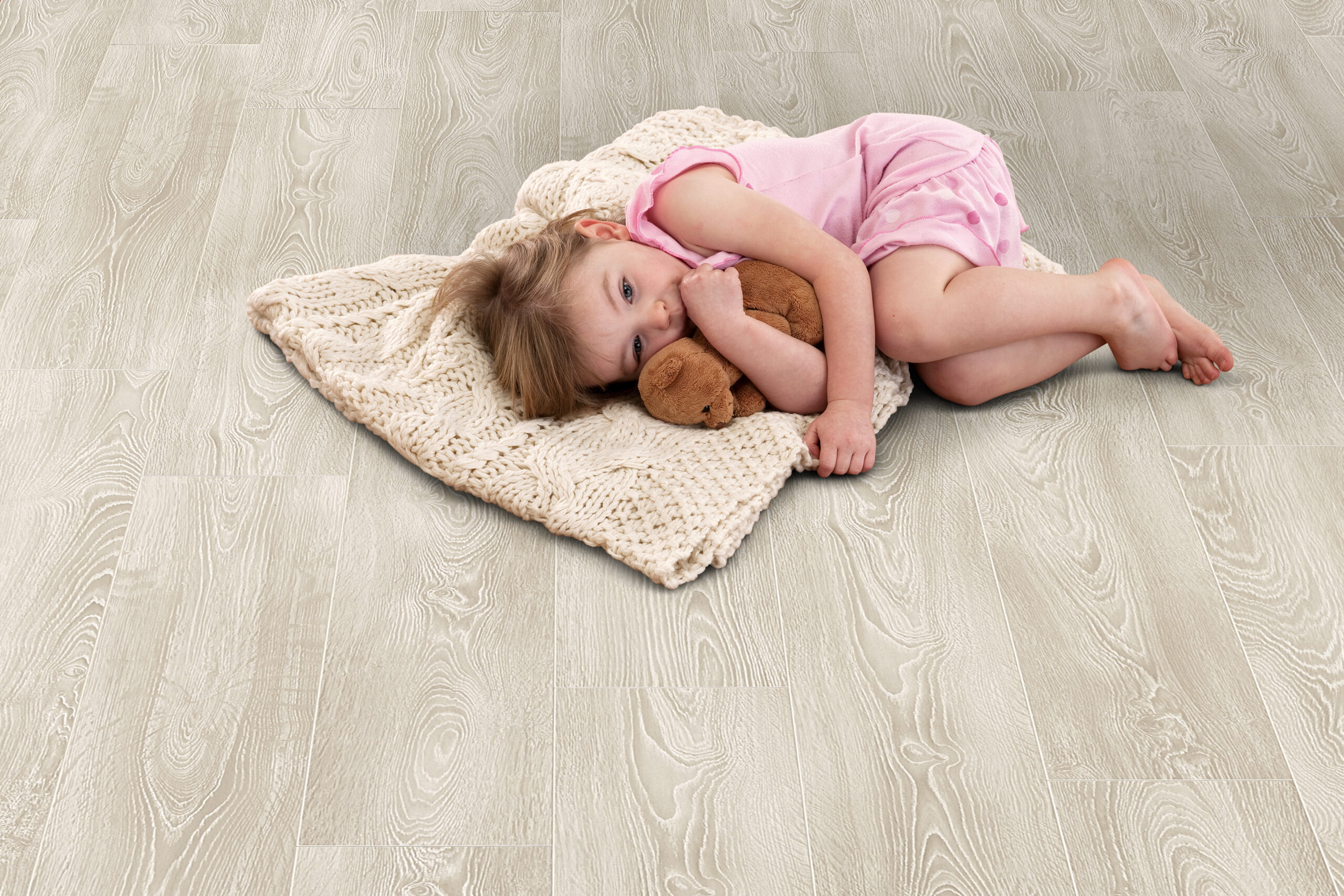 Young girl lying on Elka Frosted Oak floors